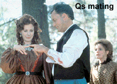 Captain Janeway looks on as Q and the female Q mate - Kate Mulgrue - John deLancie - Susie Plakson